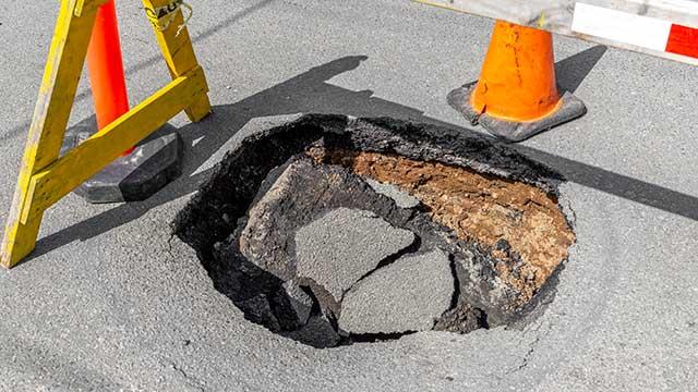 sinkhole-deep-pothole-in-a-road